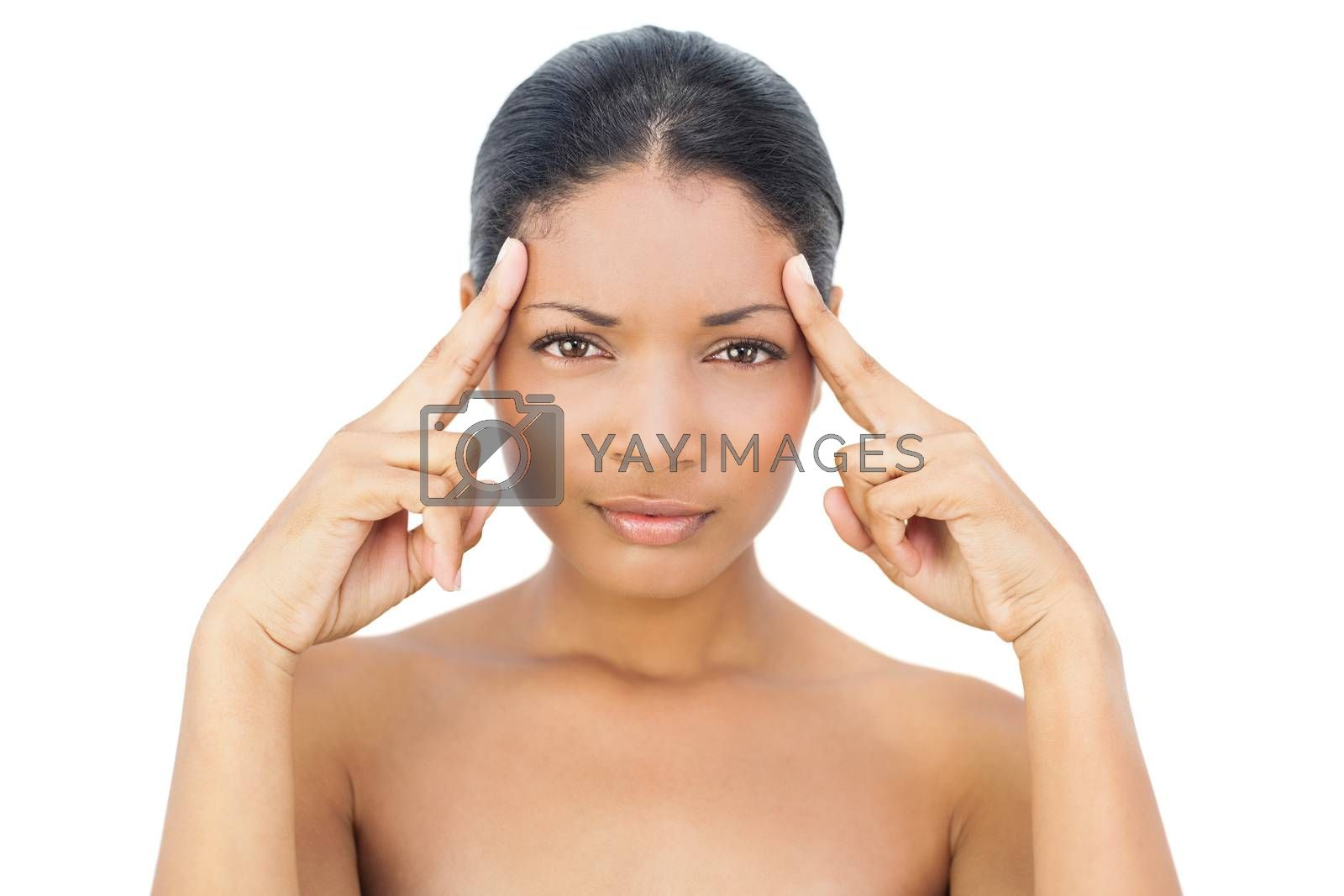 Attractive black haired model on white background having a headache