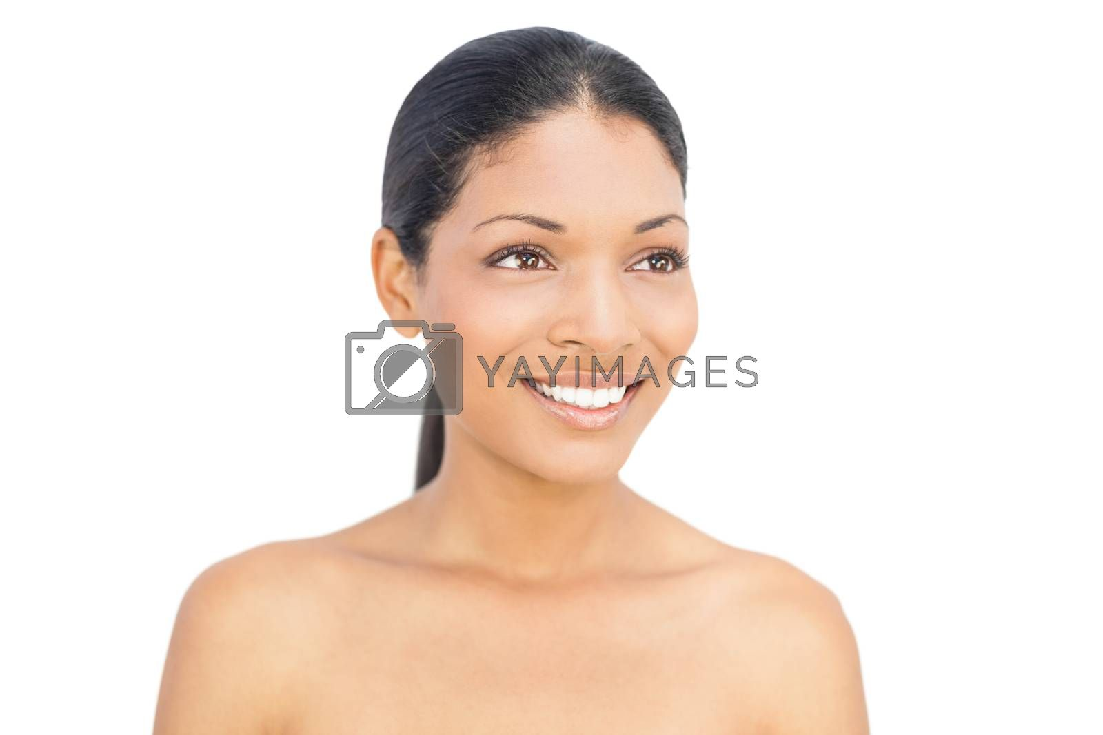 Happy black haired woman posing on white background