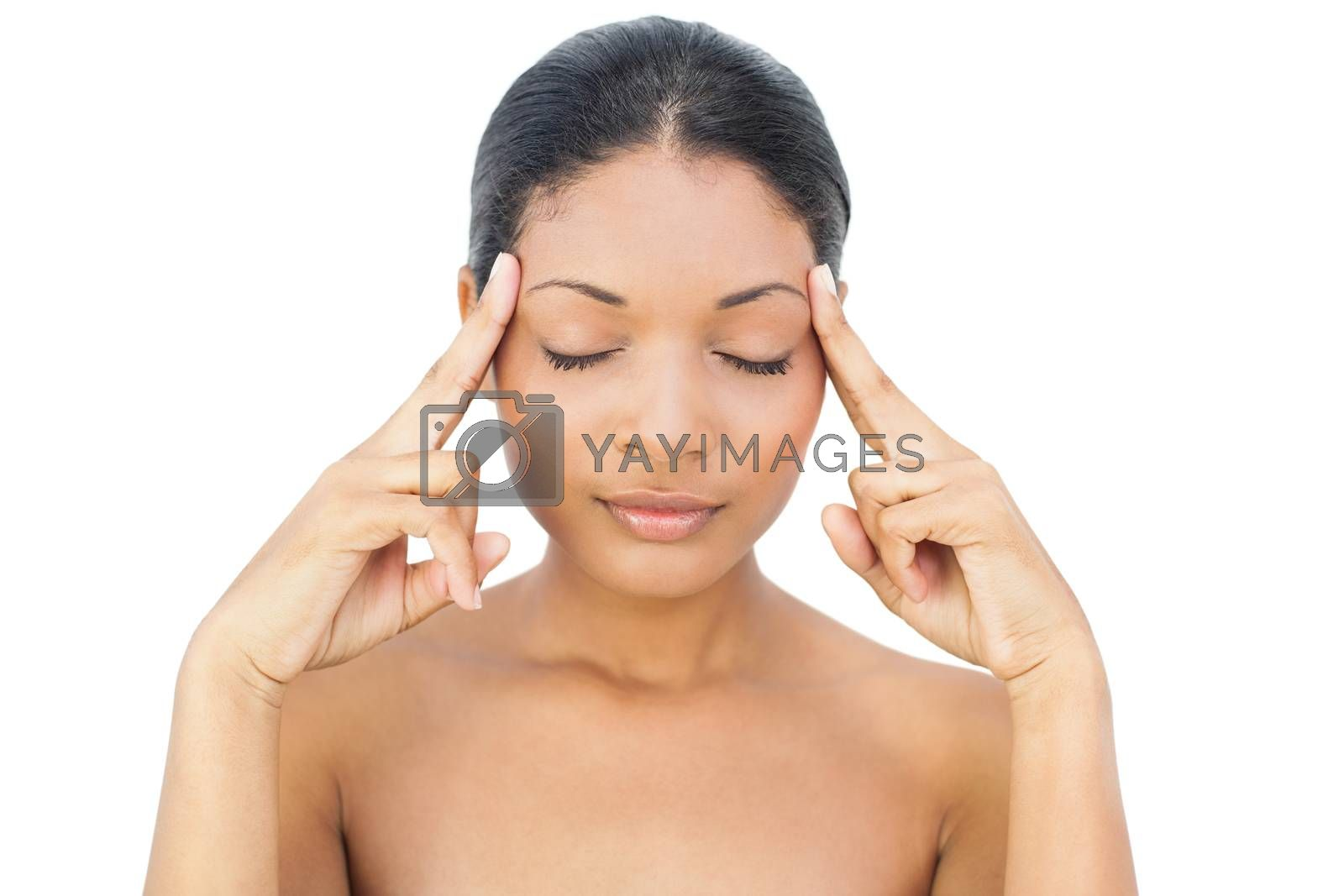 Black haired model on white background having a headache