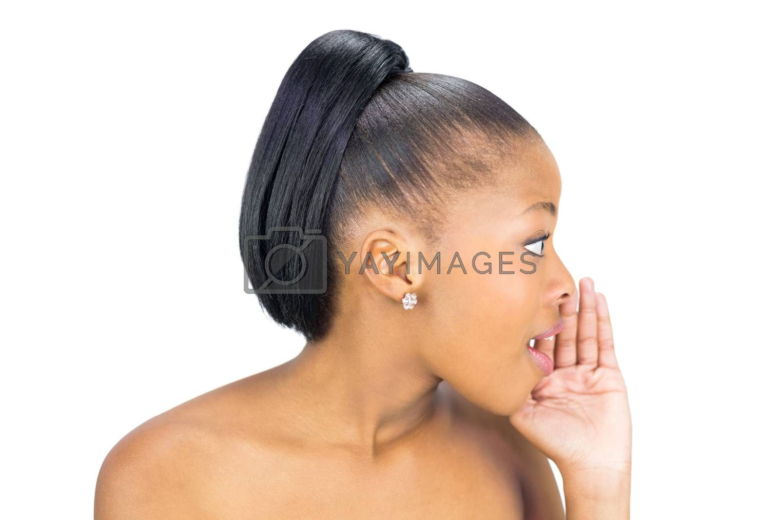 Side view of black woman whispering against white background