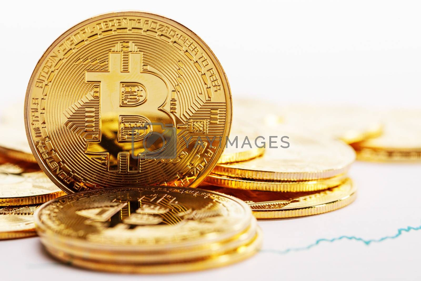 Gold coins with bitcoin sign and rate graph isolated on white background