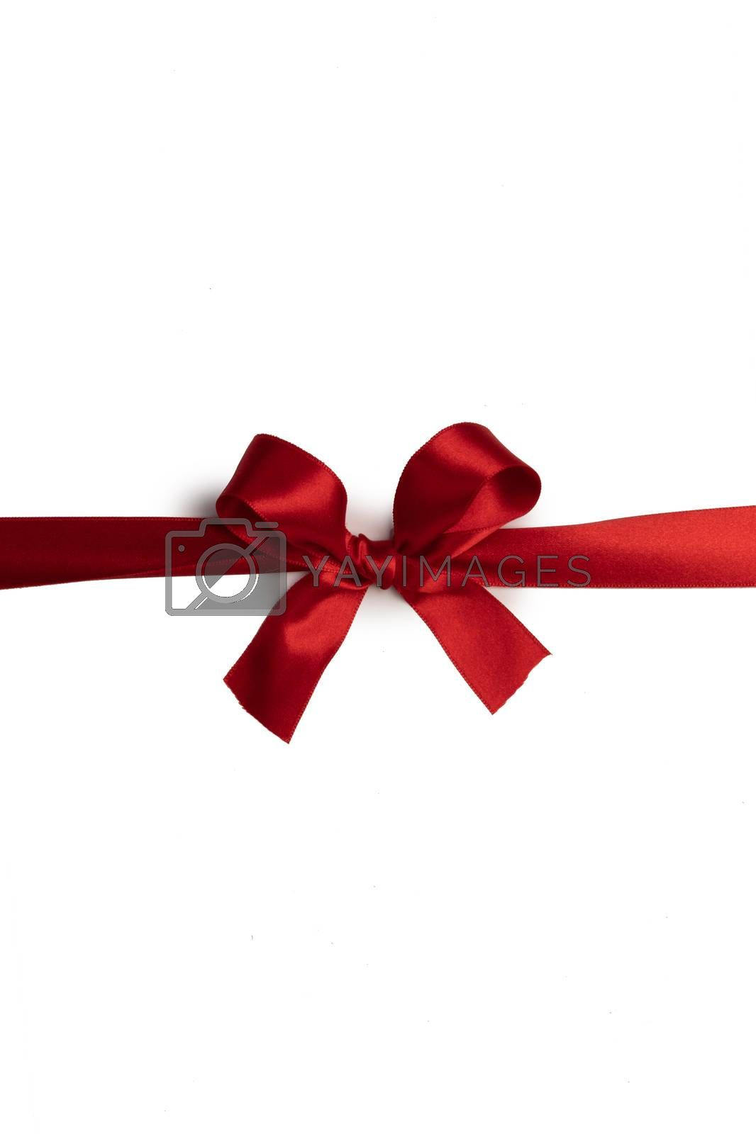 Red satin ribbon bow isolated on white background