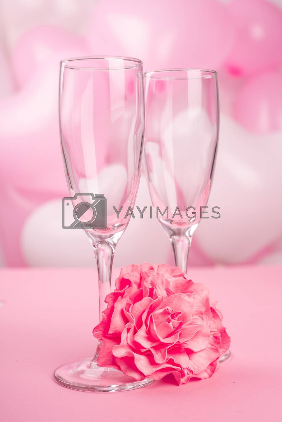 Valentines day champagne flutes glasses on pink balloons background with copy space for text