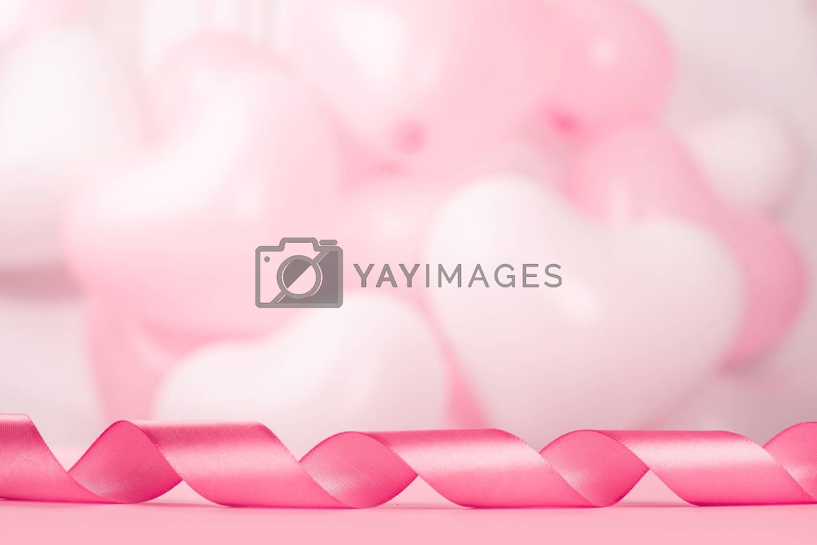 Valentine day background with pink curly satin ribbon and many balloons with copy space for text