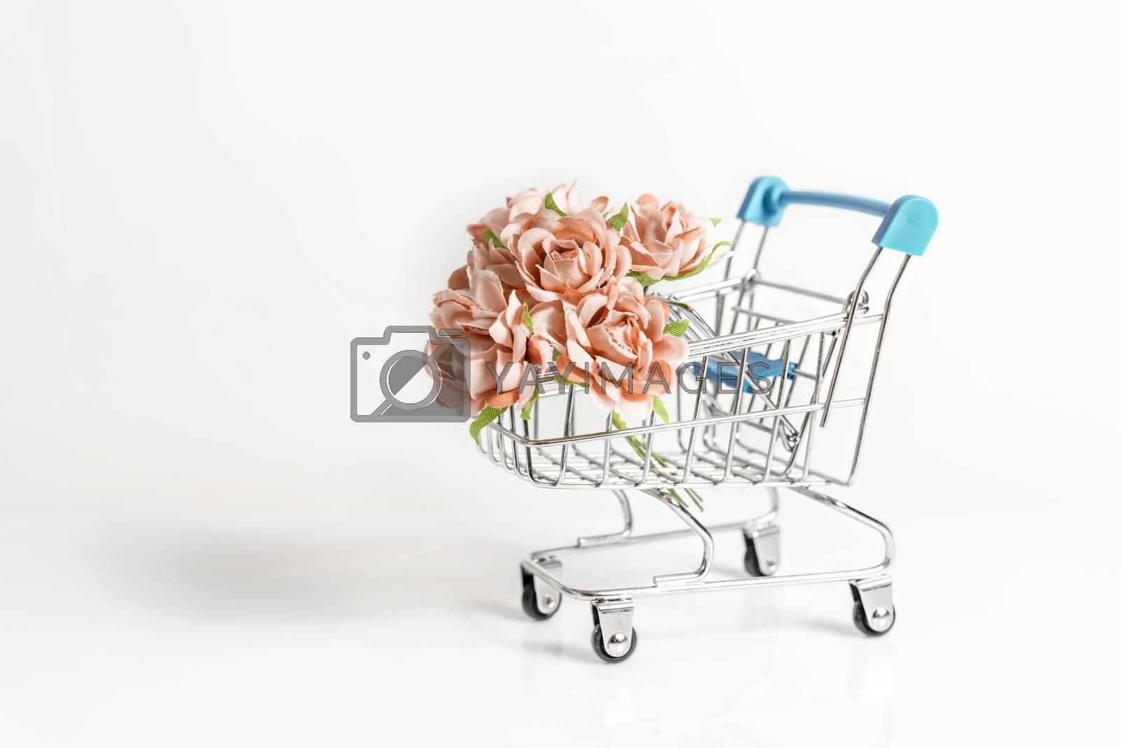 Royalty free image of flowers shopping cart by rakratchada