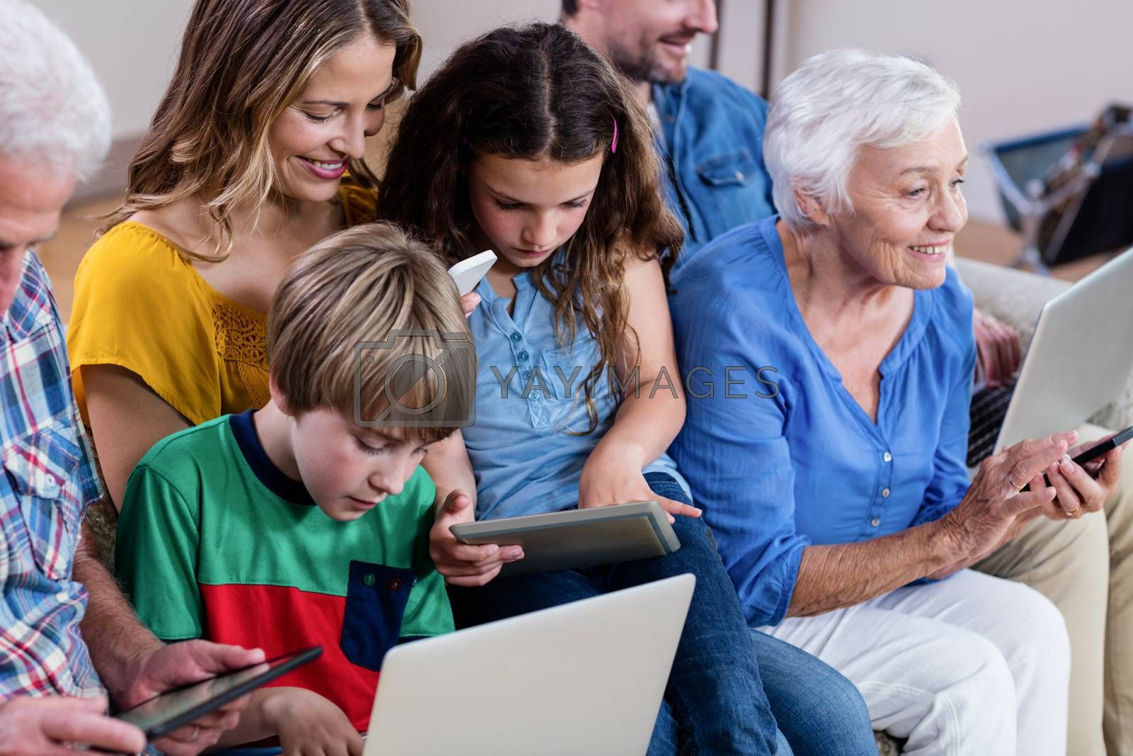 Multi-generation family using a laptop, tablet and phone at home