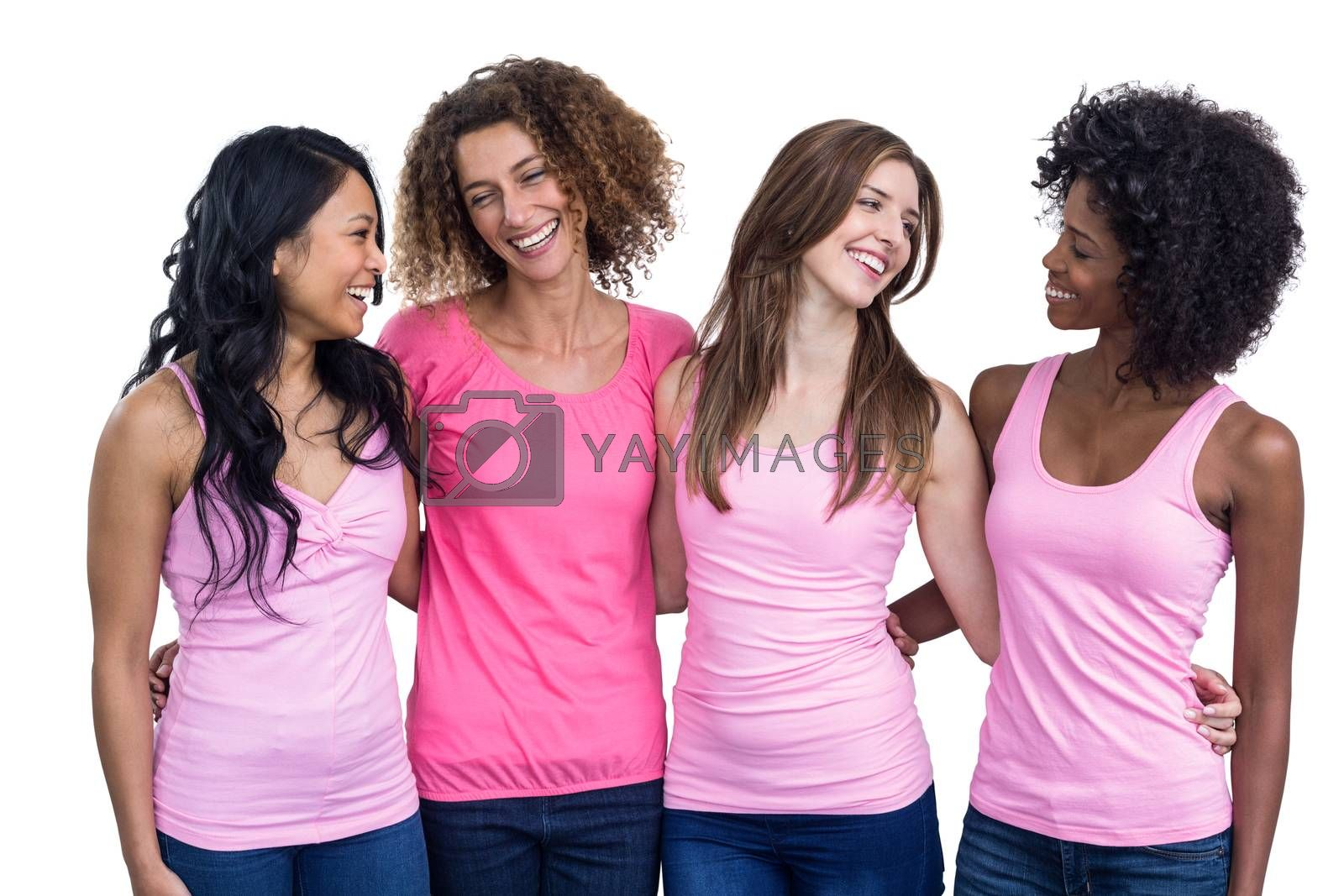 Smiling women in pink outfits standing together on white background