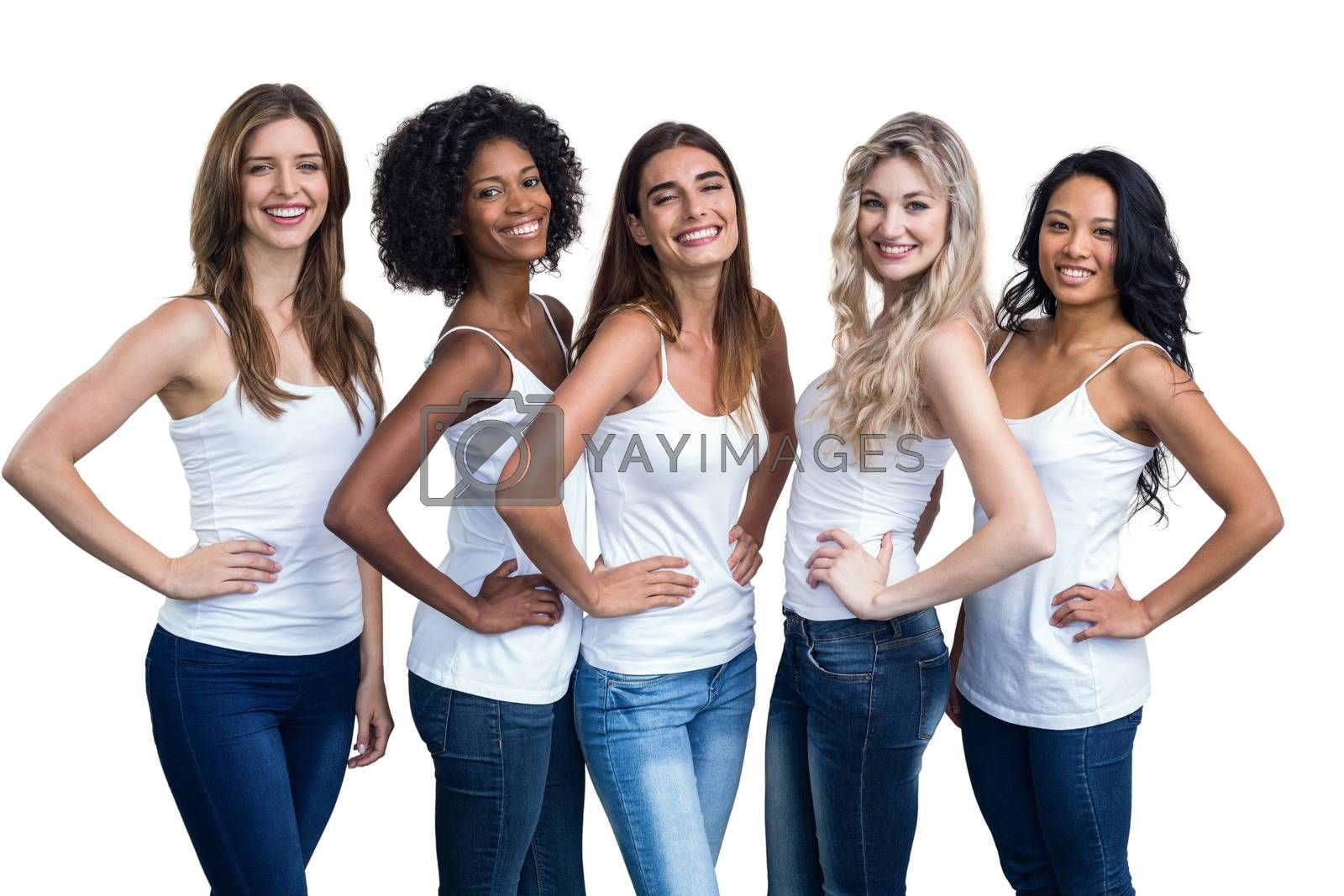 Portrait of multiethnic women standing with hand on hip on white background