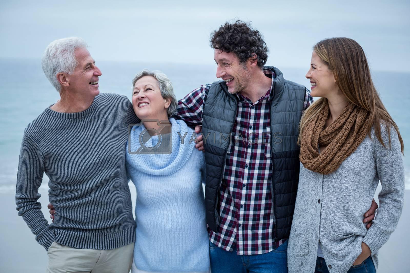 Cheerful family enjoying on shore at beach