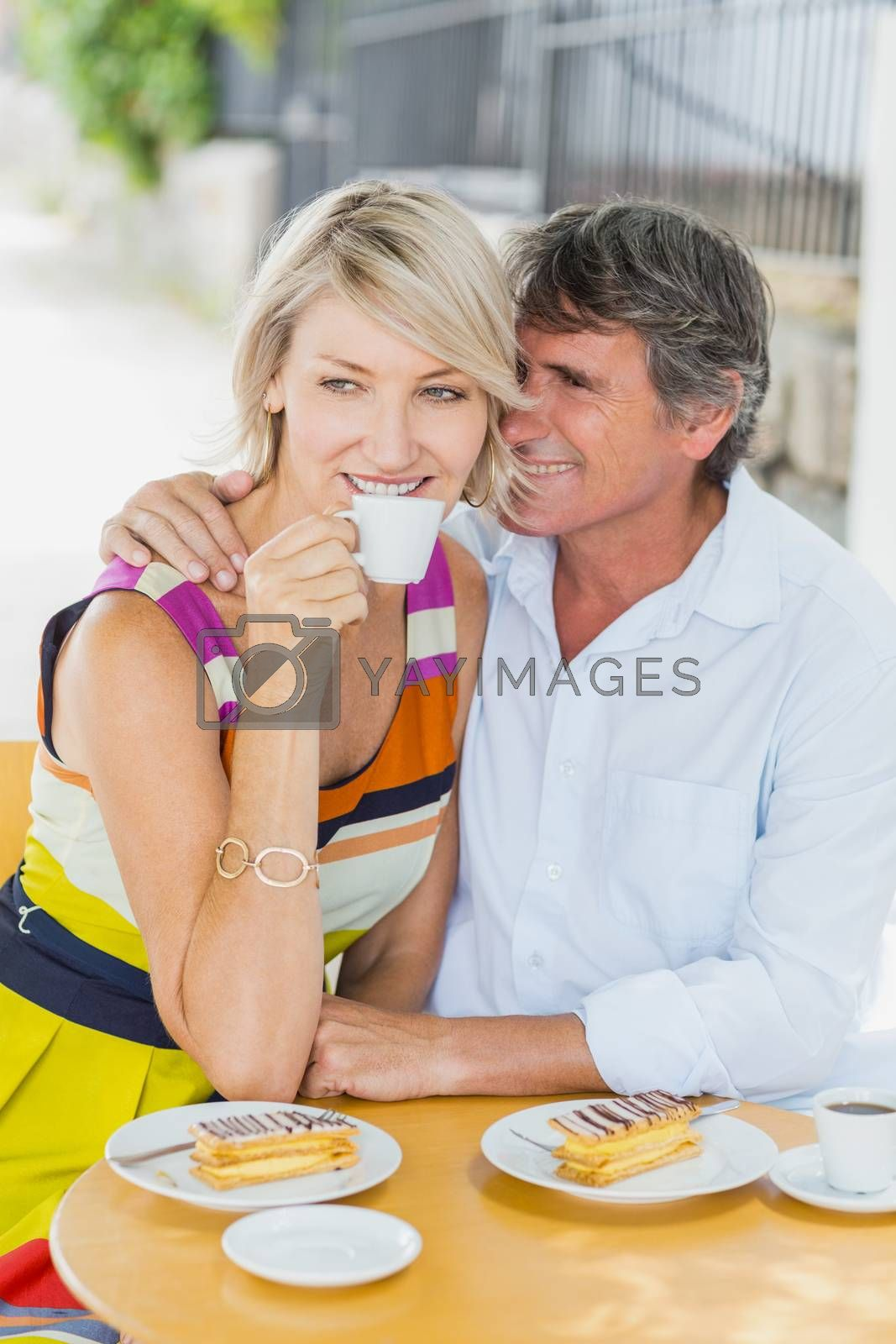 Happy man with woman sitting at cafe