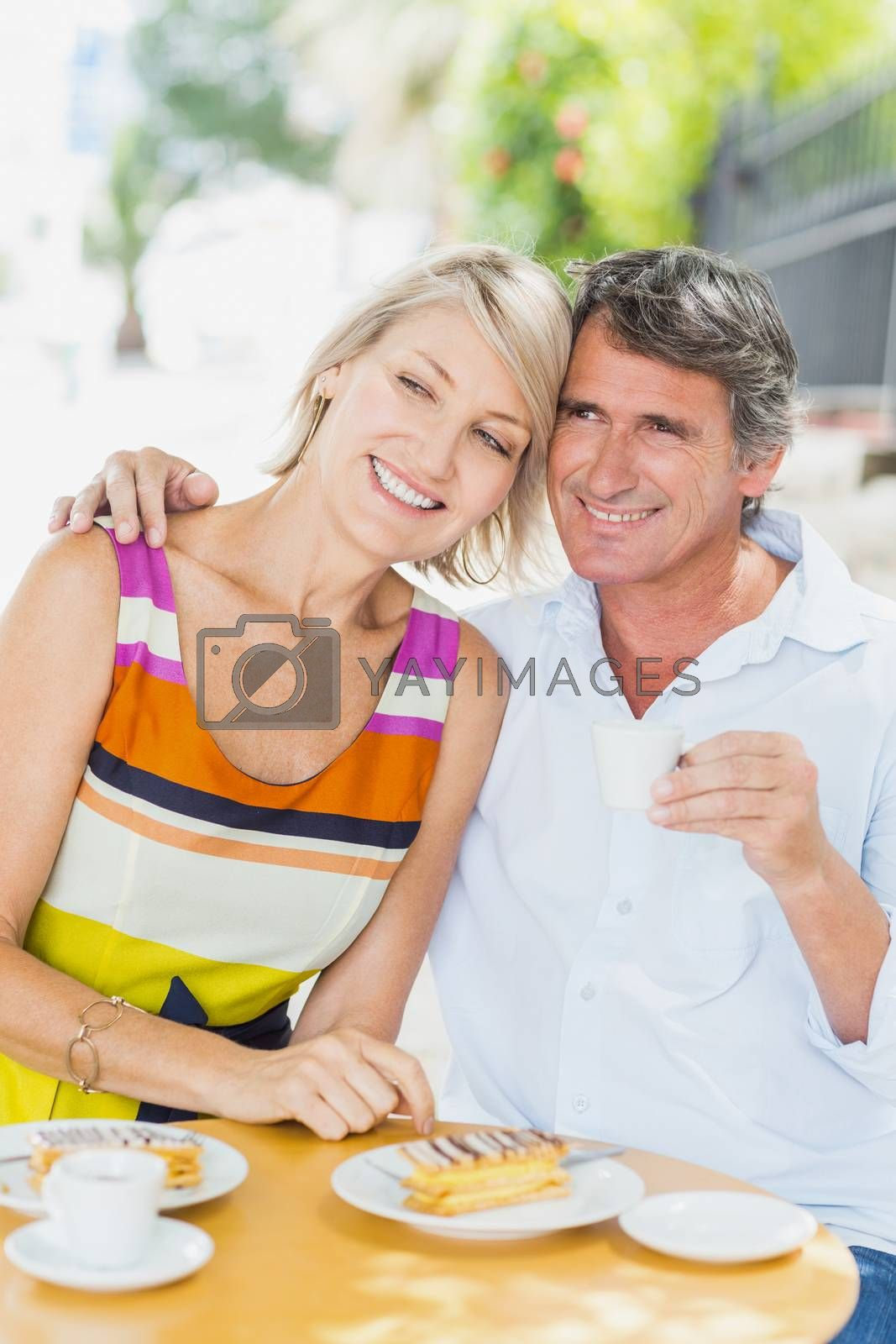 Couple enjoying coffee with food at cafe