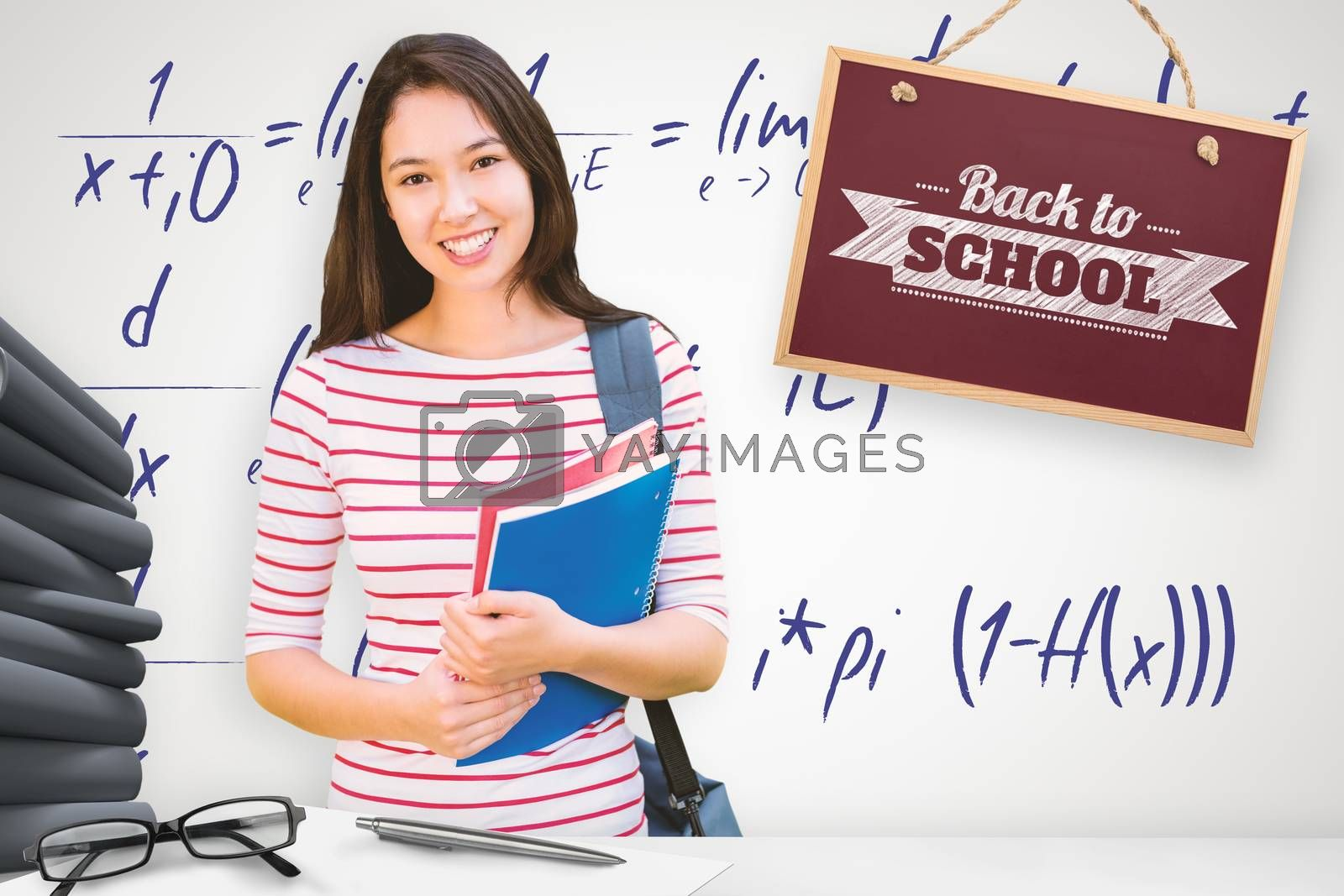 College girl holding books with blurred students in park against grey background