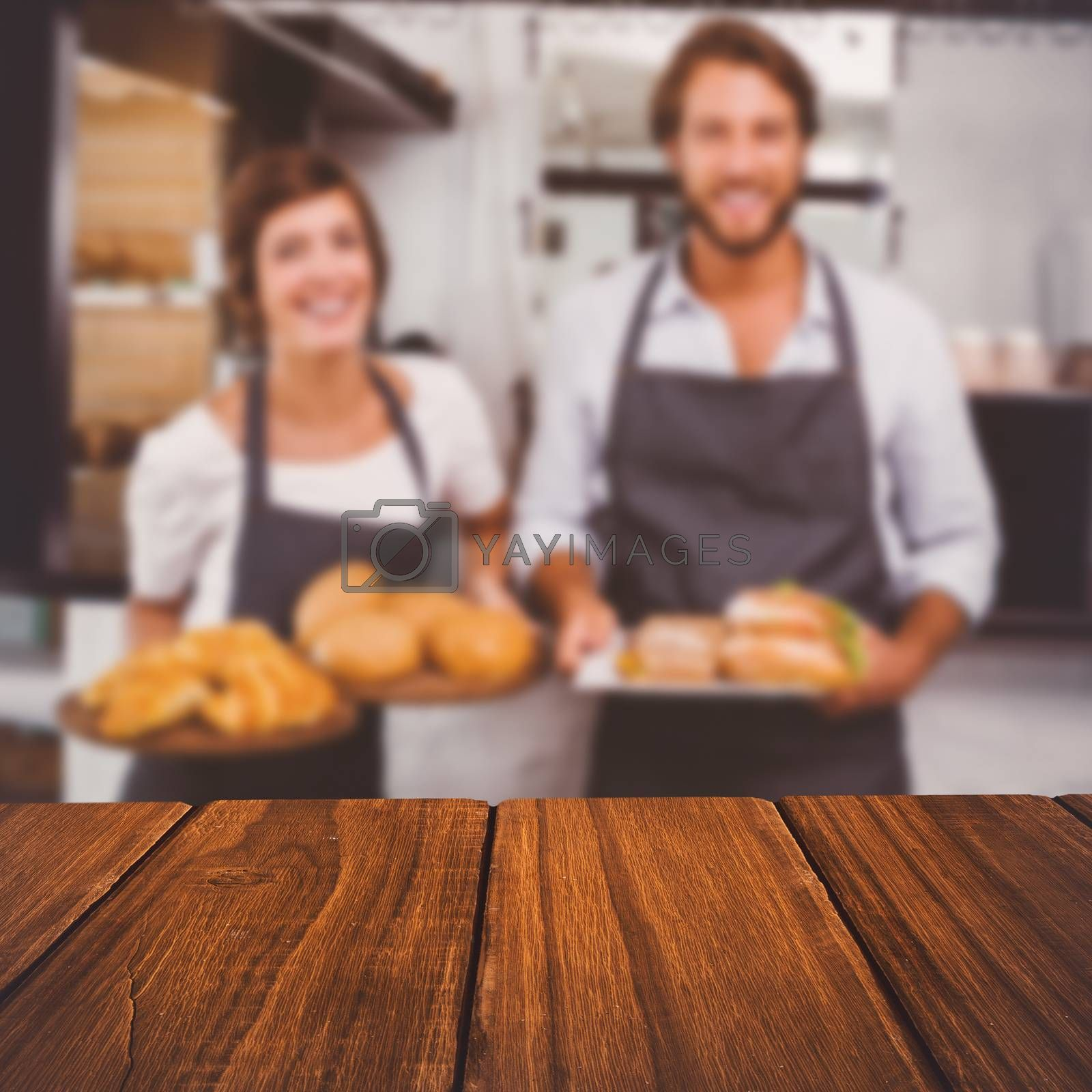 High angle view of hardwood floor against happy servers holding plates of food