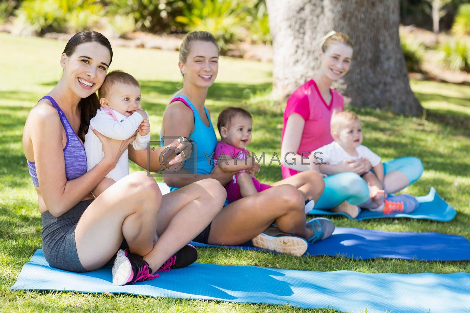 Women sitting with their babies  by Wavebreakmedia