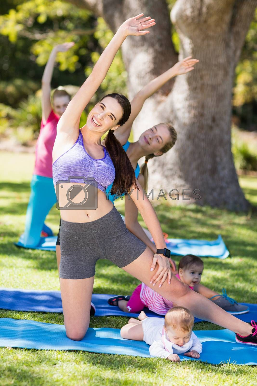 Women exercising with their babies  by Wavebreakmedia