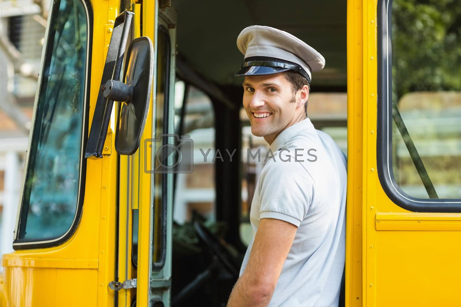Bus driver smiling while entering in bus by Wavebreakmedia