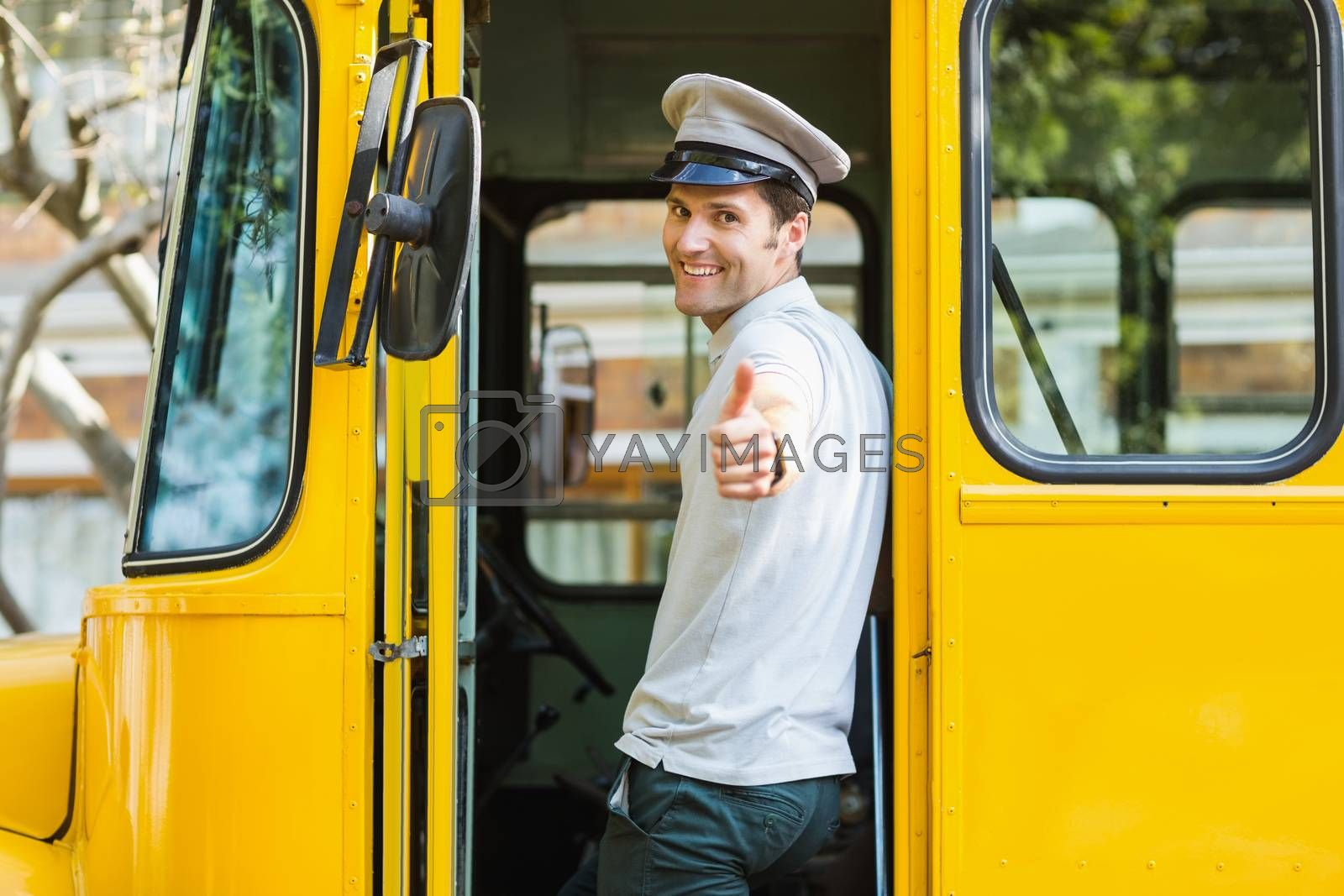 Portrait of bus driver showing thumbs up while entering in bus