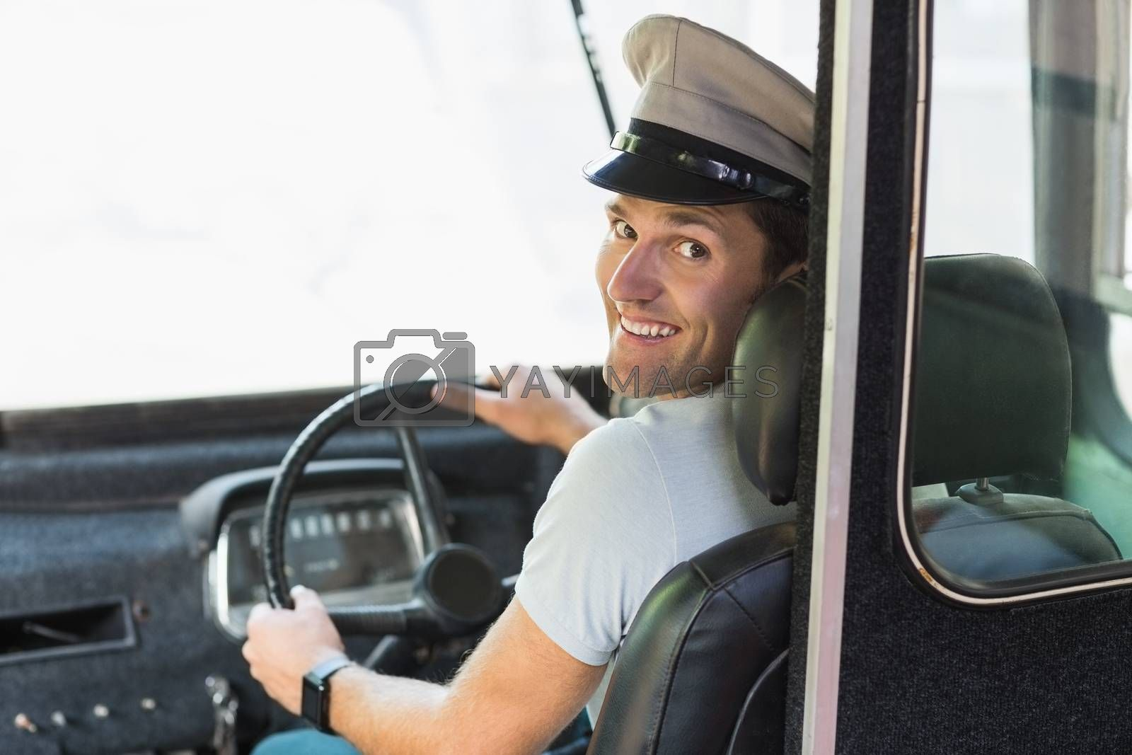 Smiling bus driver driving a bus by Wavebreakmedia