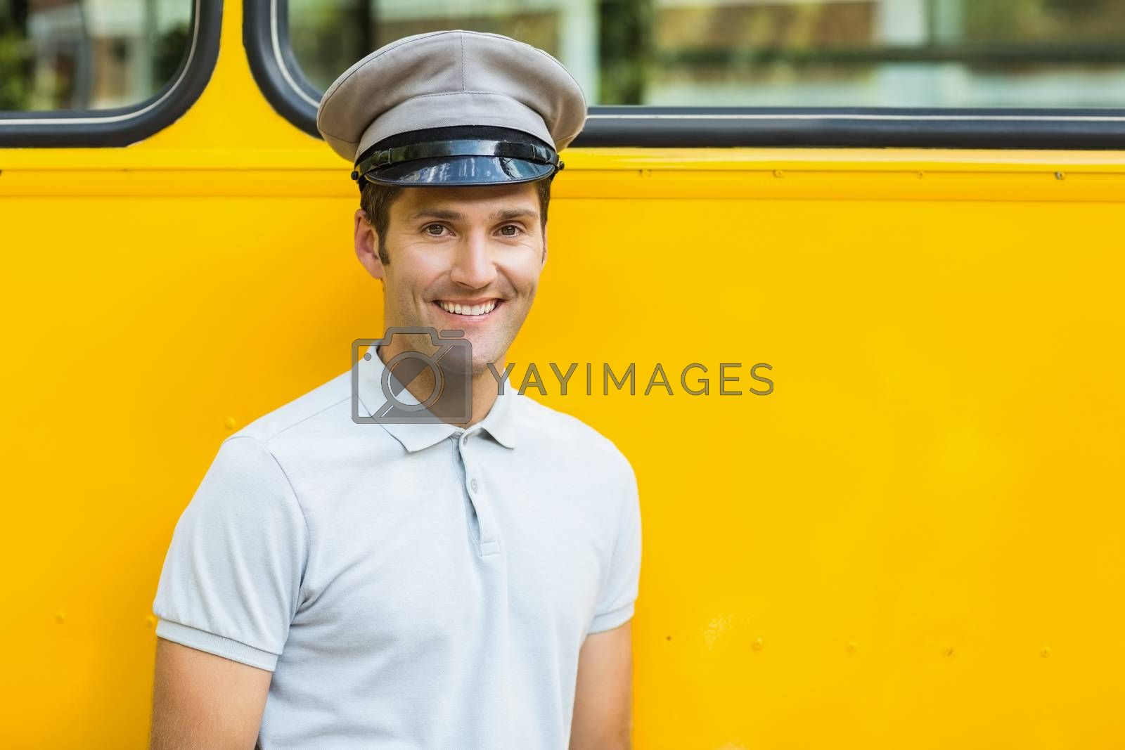 Bus driver smiling in front of bus by Wavebreakmedia