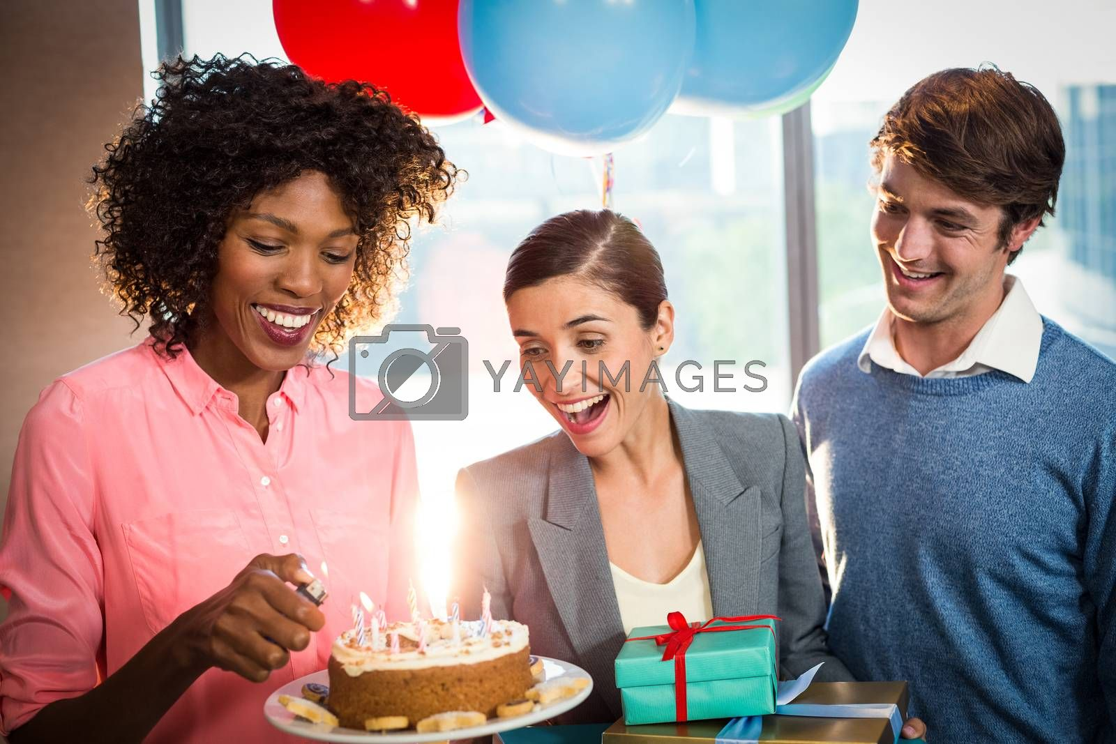 Business people celebrating birthday by Wavebreakmedia