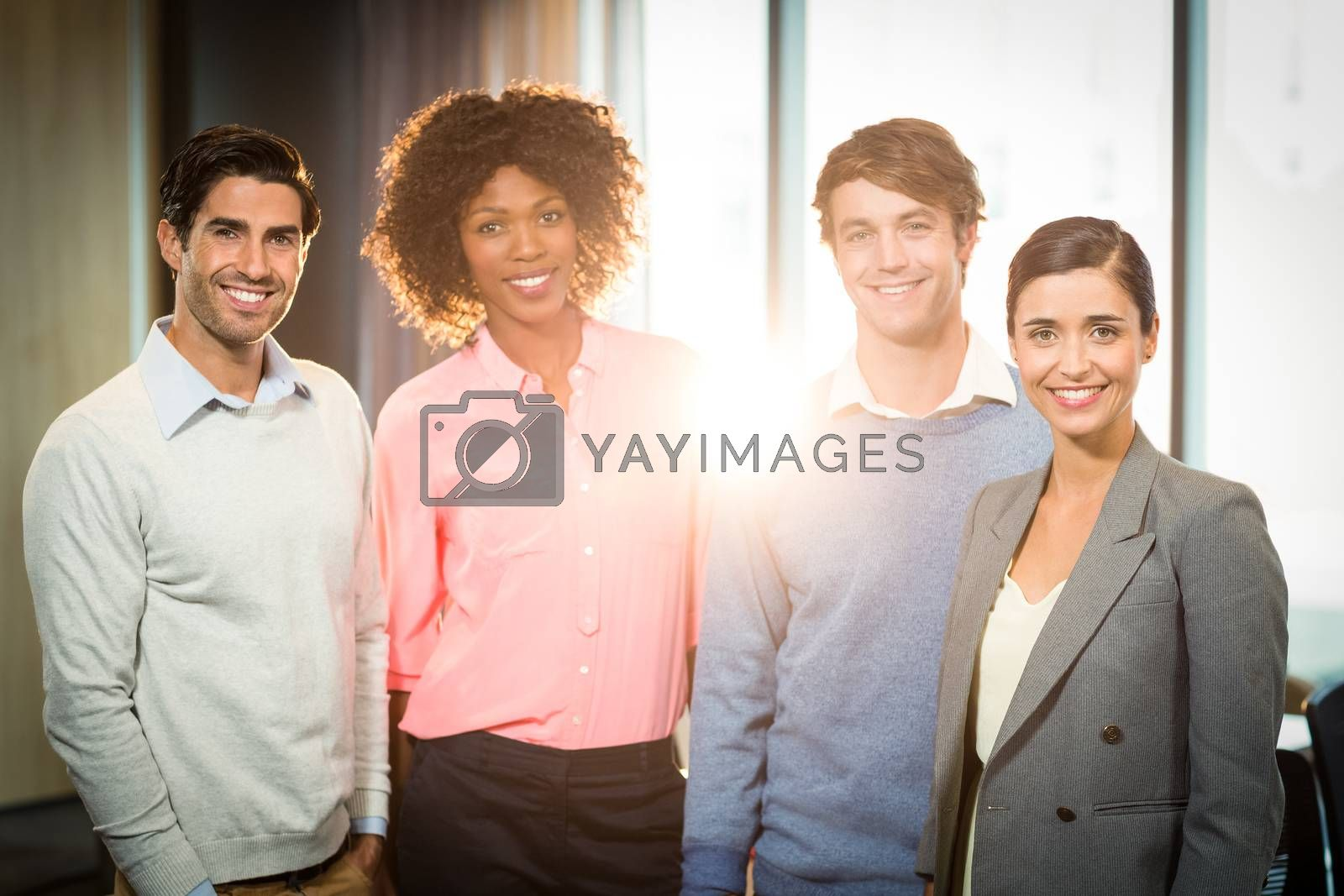 Portrait of business people smiling in office
