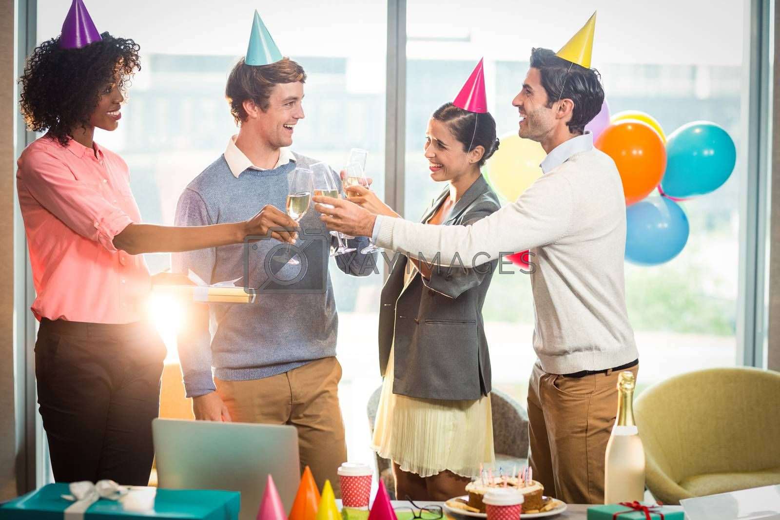 Business people celebrating birthday in office