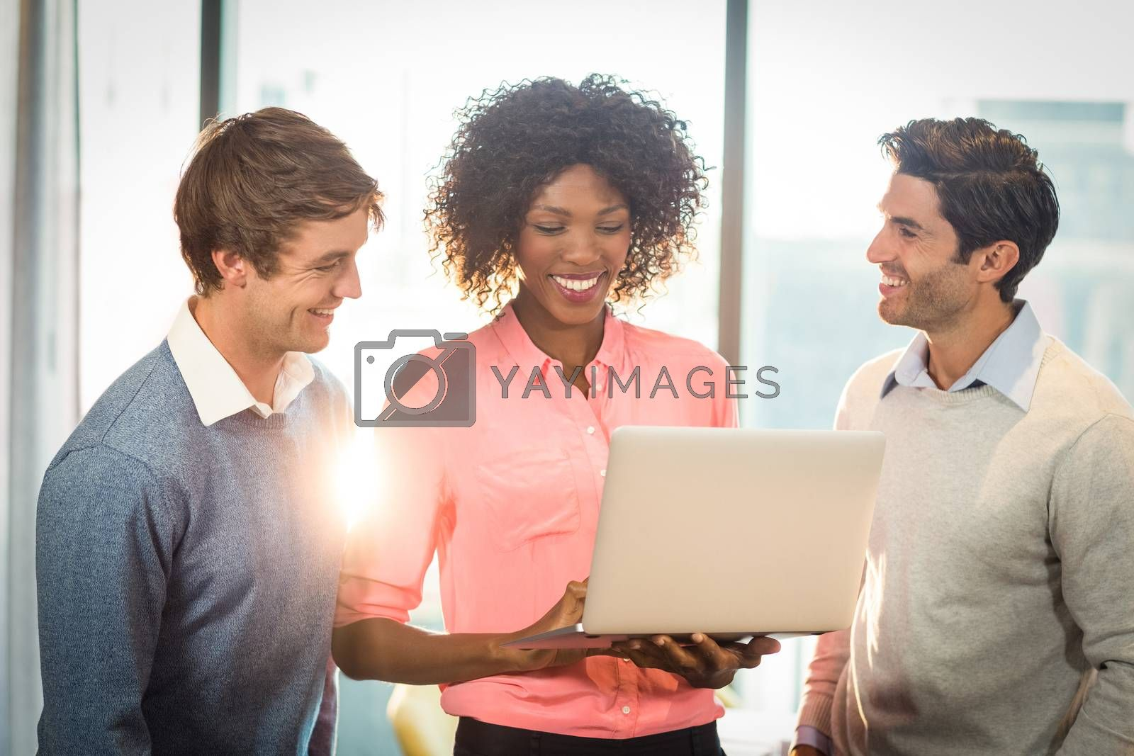 Business people discussing over laptop by Wavebreakmedia