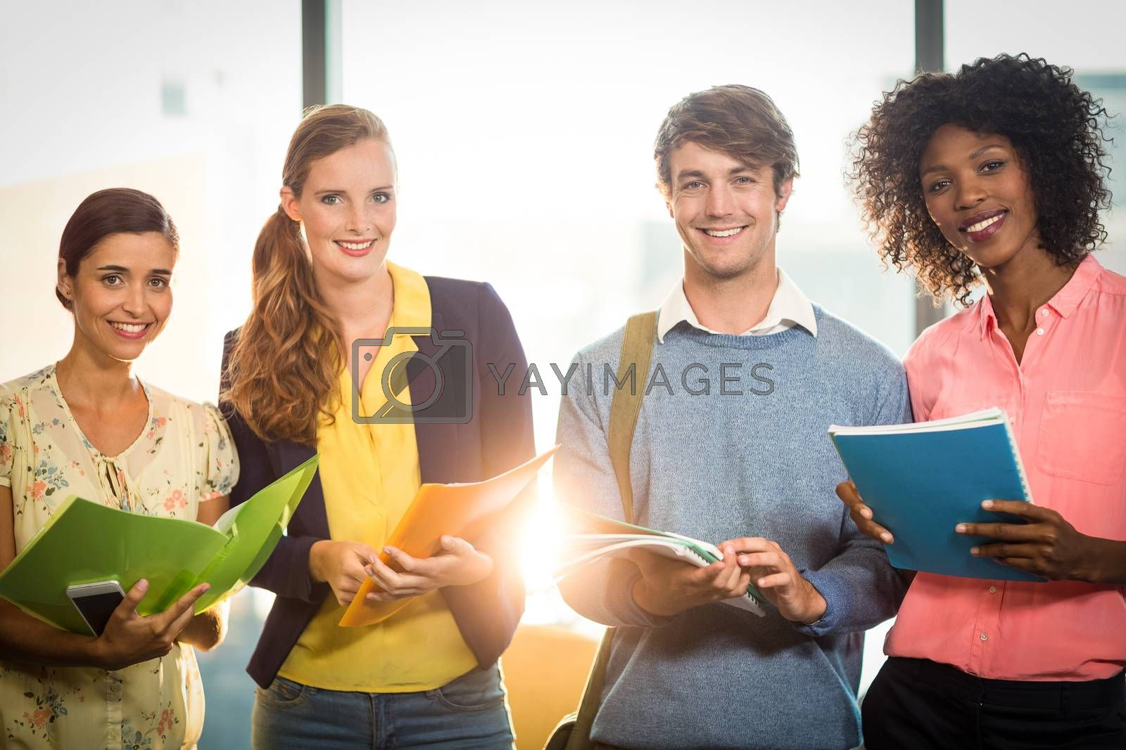 Business people holding files  by Wavebreakmedia