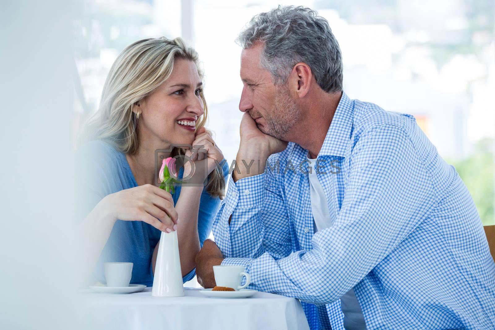 Happy romantic couple in restaurant