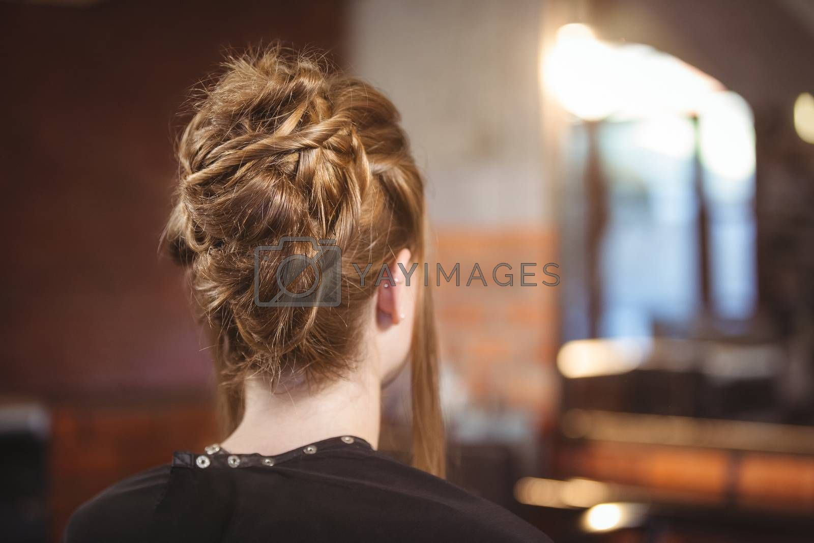 Rear view of woman with updo hairstyle at a salon