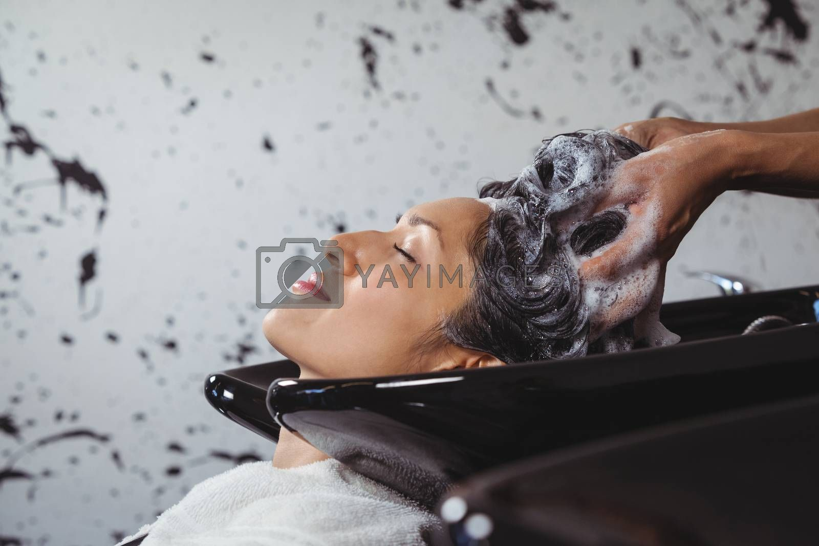 Woman getting her hair wash at a salon