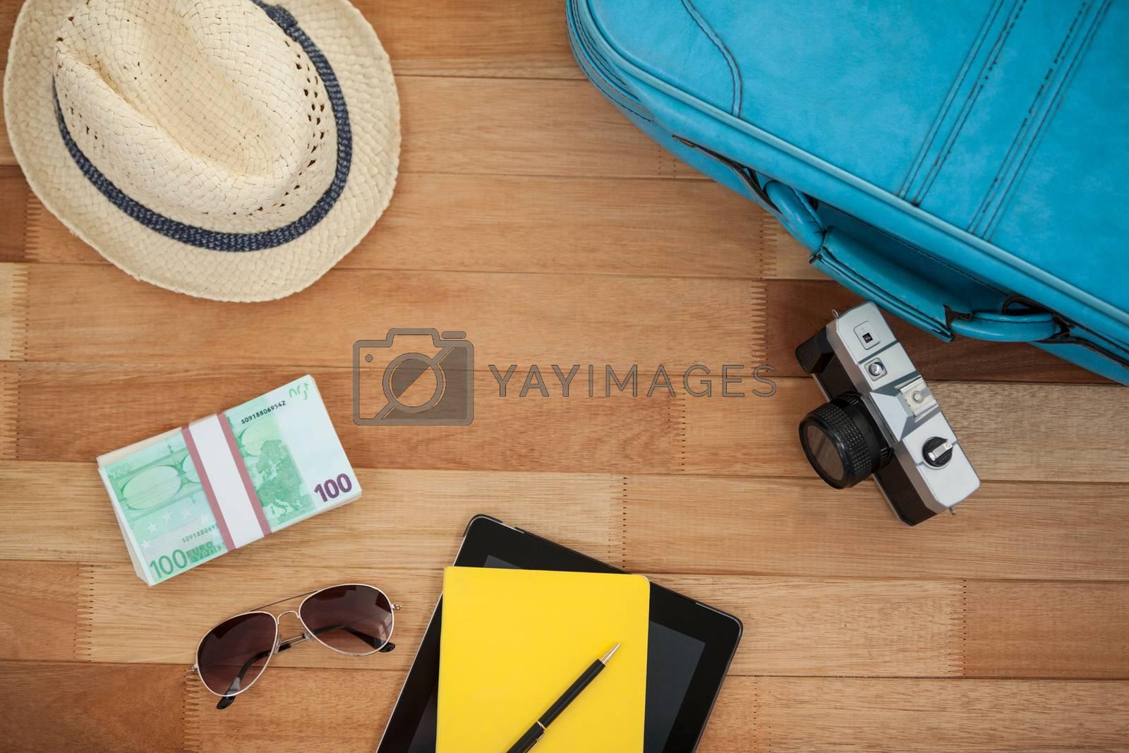 Travel accessories on wooden floor by Wavebreakmedia