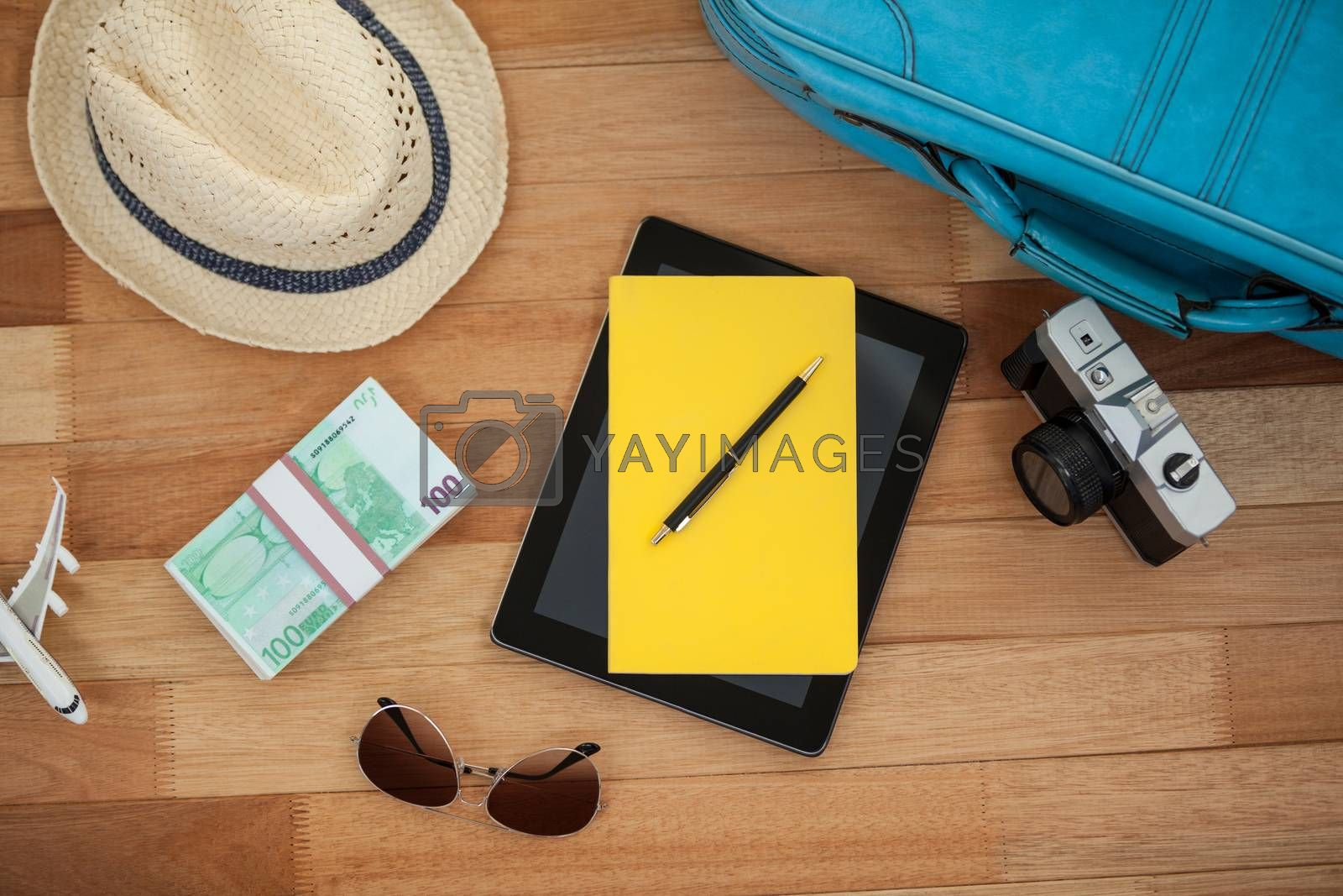 Travel accessories on wooden floor by Wavebreakmedia