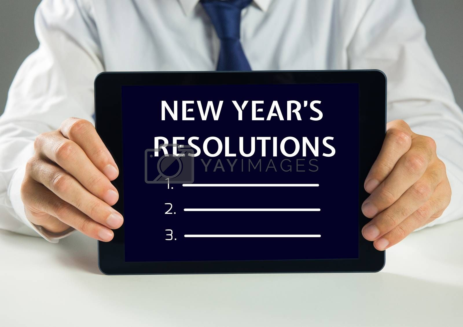 Man holding a digital tablet showing list of new year resolution goals