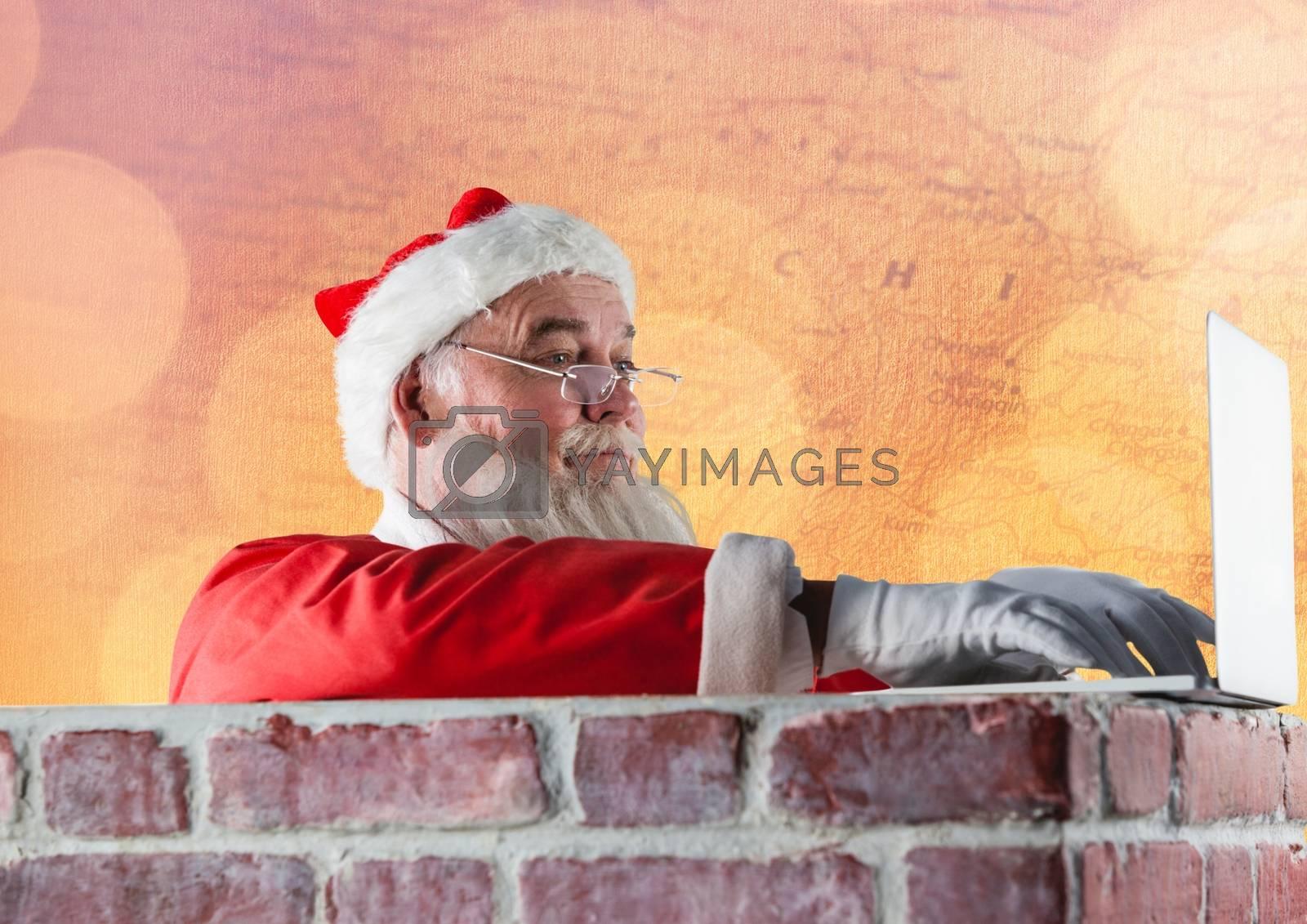 Santa claus using a laptop on brick wall