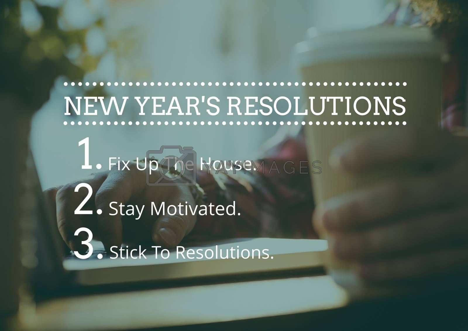 New year resolution goals against hand holding coffee cup in background