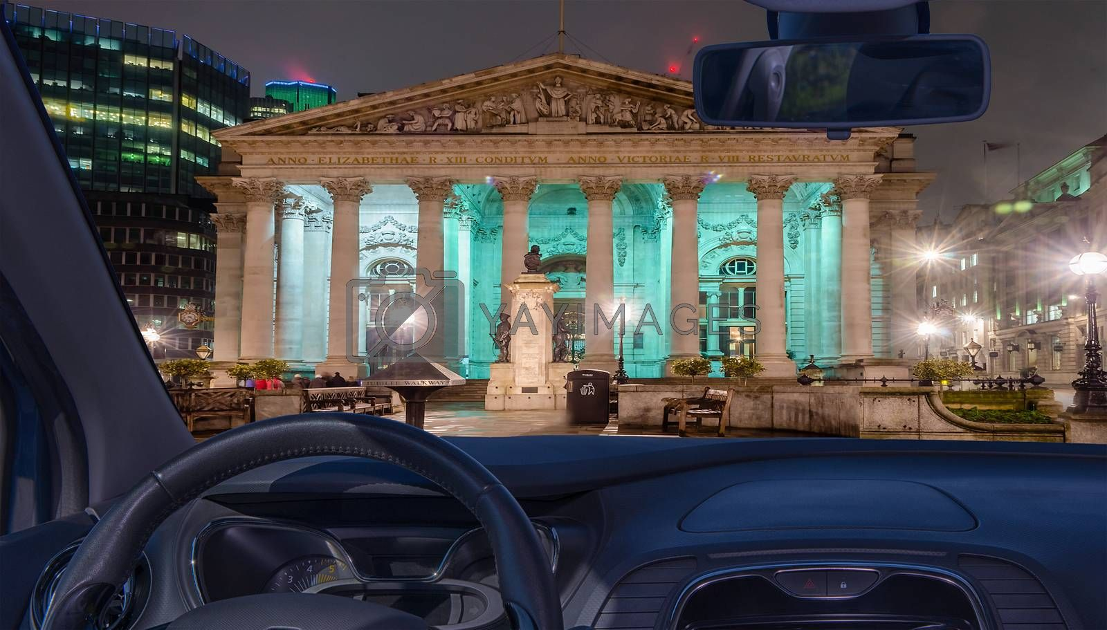 Looking through a car windshield with view of the Royal Exchange Building, London, UK