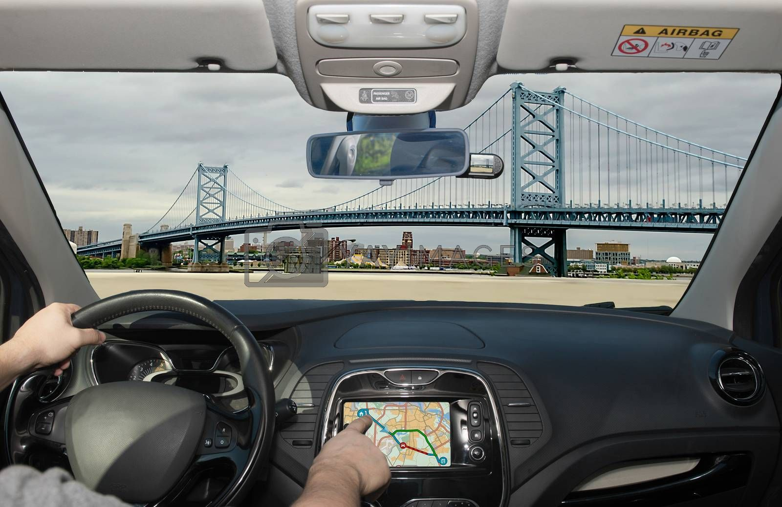 Driving a car while using the touch screen of a GPS navigation system Benjamin Franklin Bridge, Philadelphia, Pennsylvania, USA