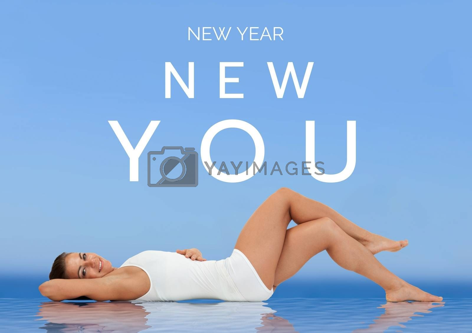 Digital Composite of New year text and laying woman against blue background