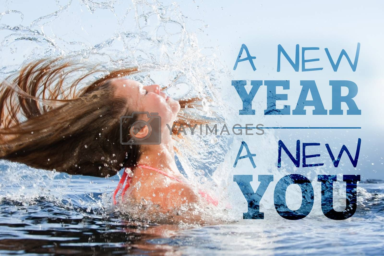 New year new you against beautiful woman raising her head out of the water