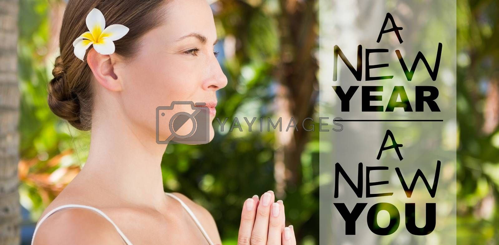 New year new you against side view of beautiful natural brunette doing yoga