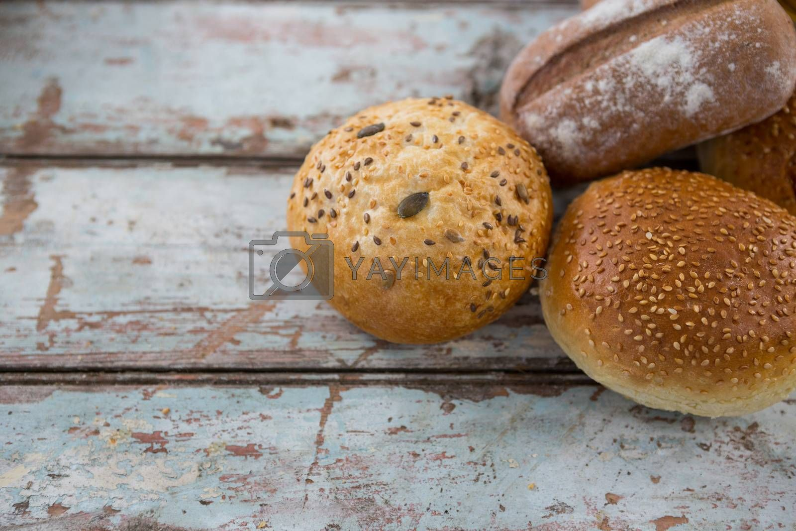 Close-up of bread loaves on wooden table