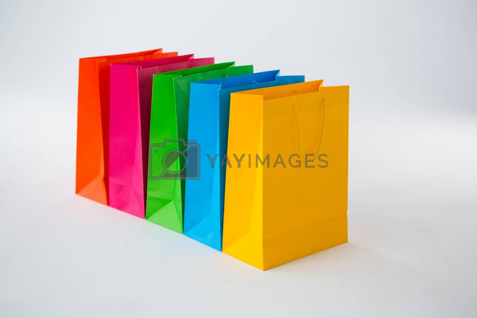 Colorful shopping bags against white background