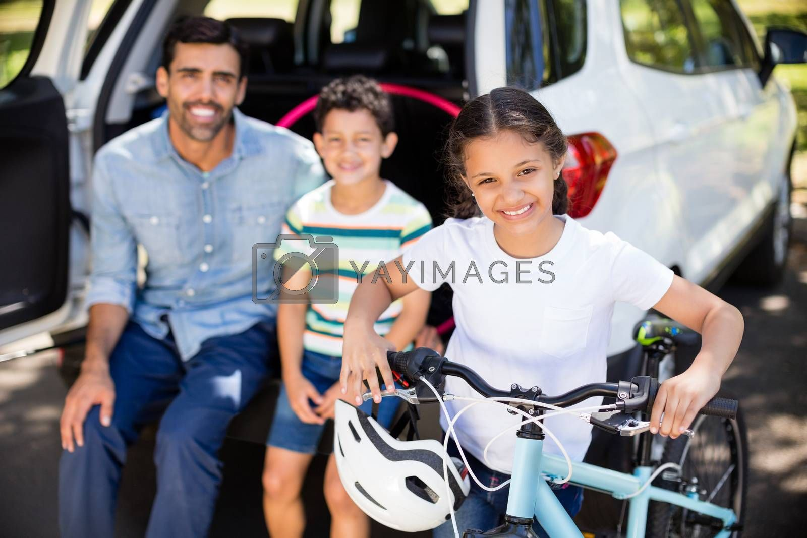 Portrait of father with son and daughter having fun in park by Wavebreakmedia