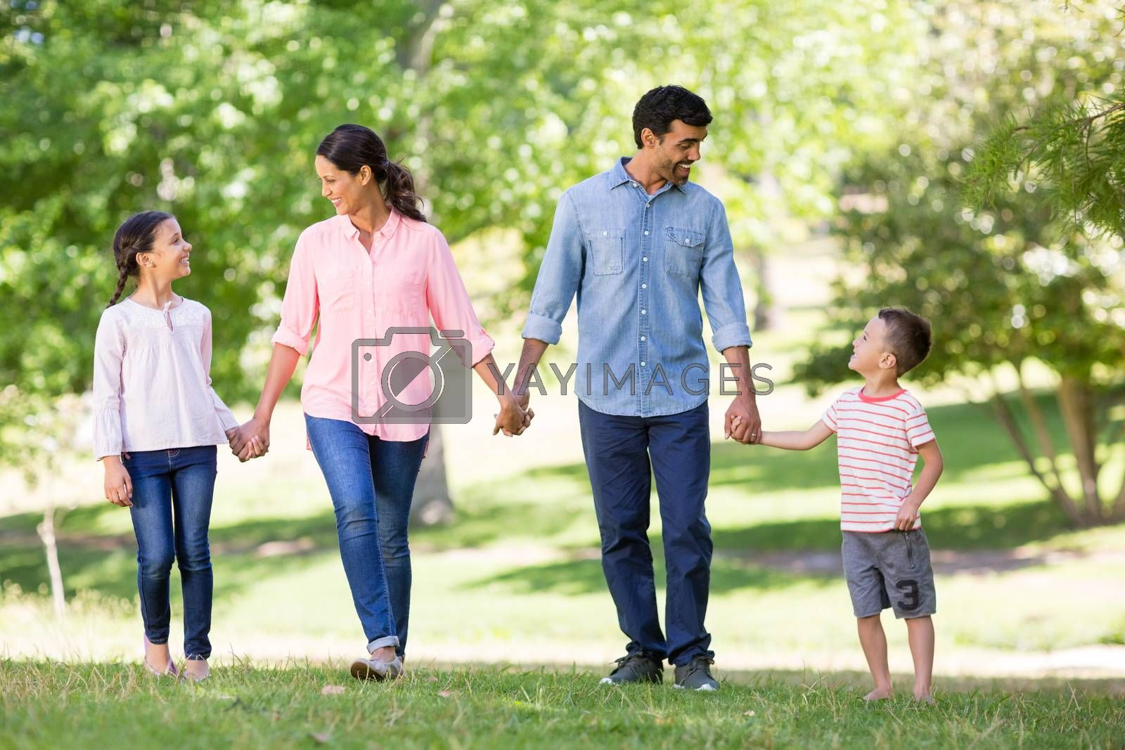 Happy family enjoying together in park on a sunny day