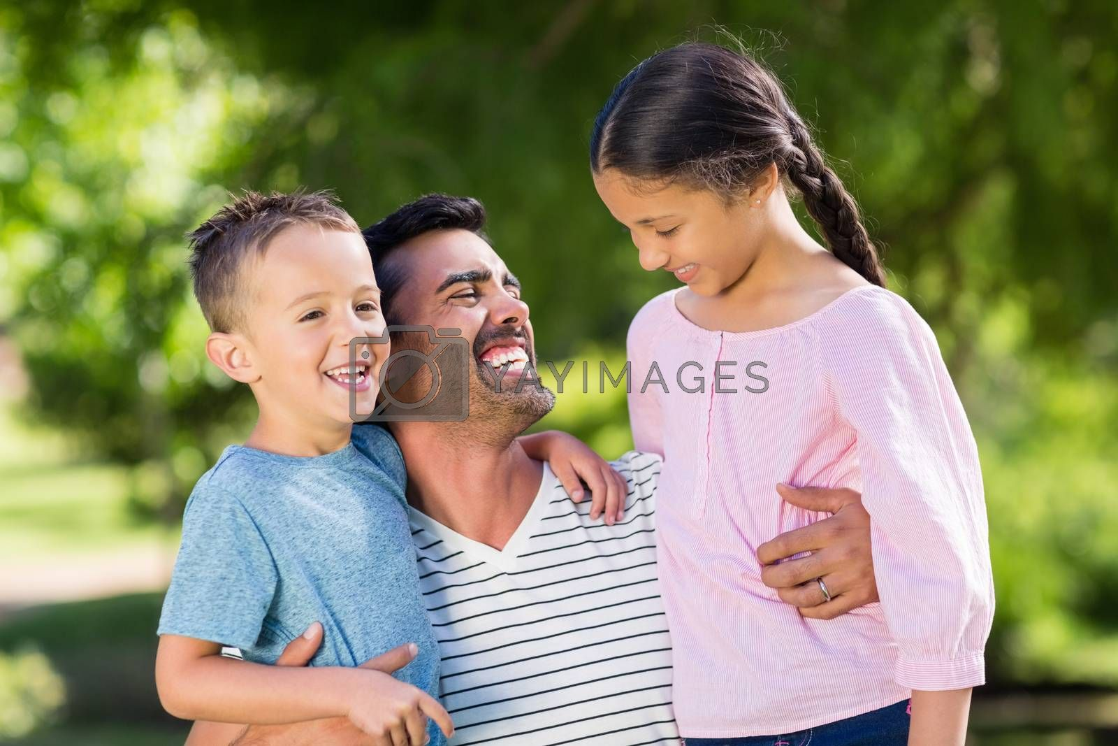 Father having fun with his son and daughter in park by Wavebreakmedia