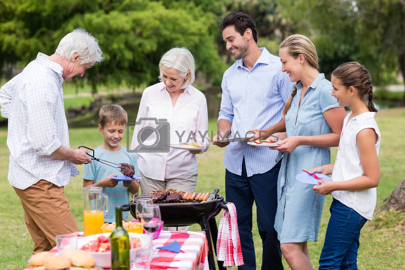 Happy family enjoying together in park