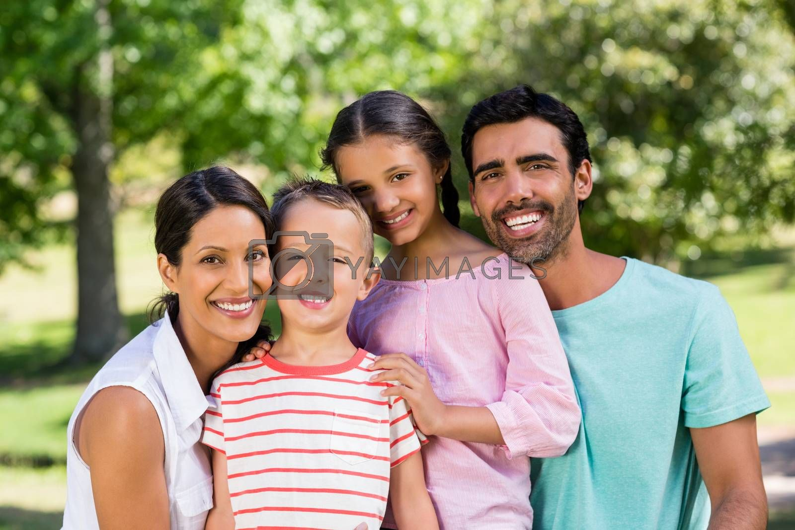 Portrait of happy family in park on a sunny day