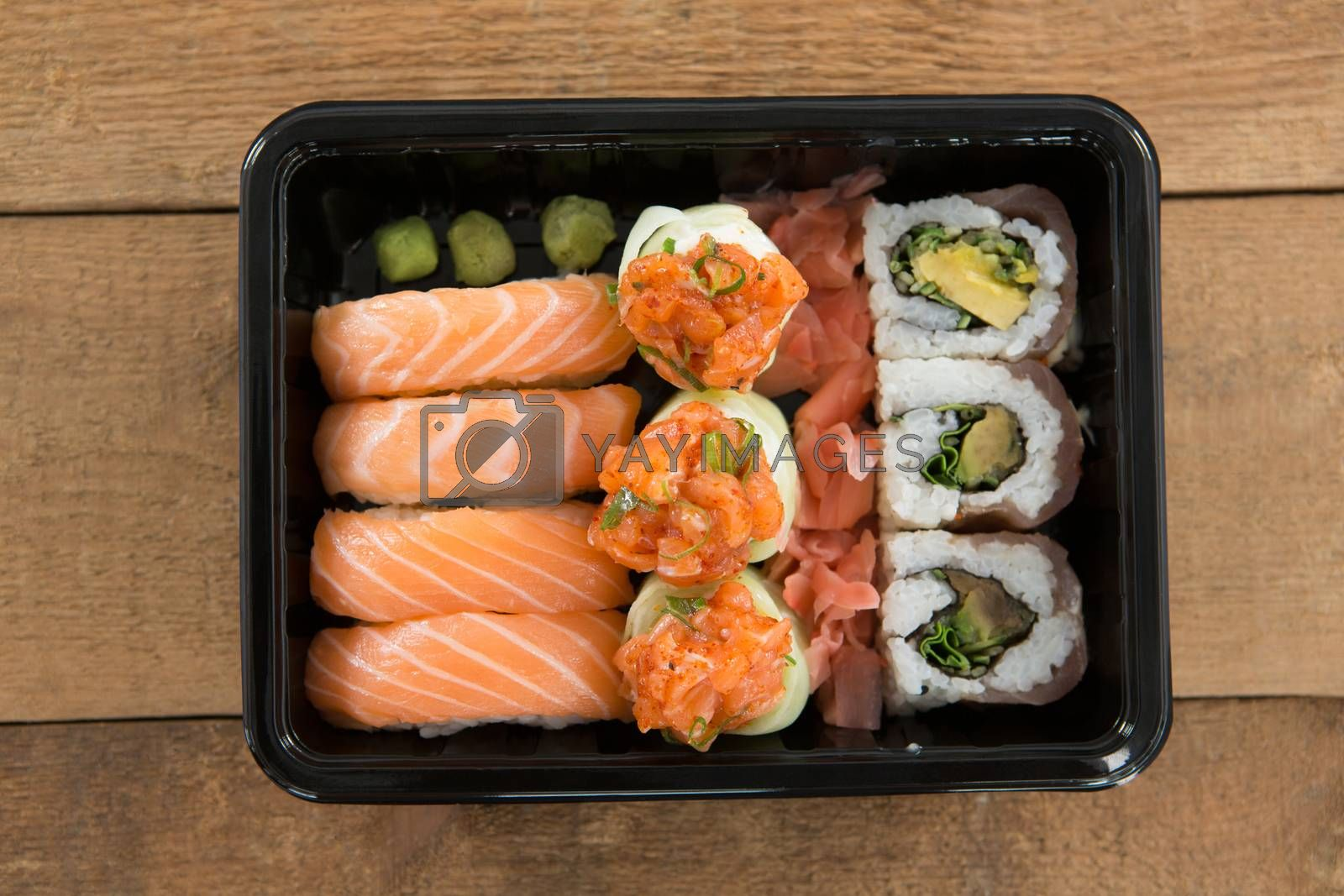 Sushi rolls with salmon in plastic tray