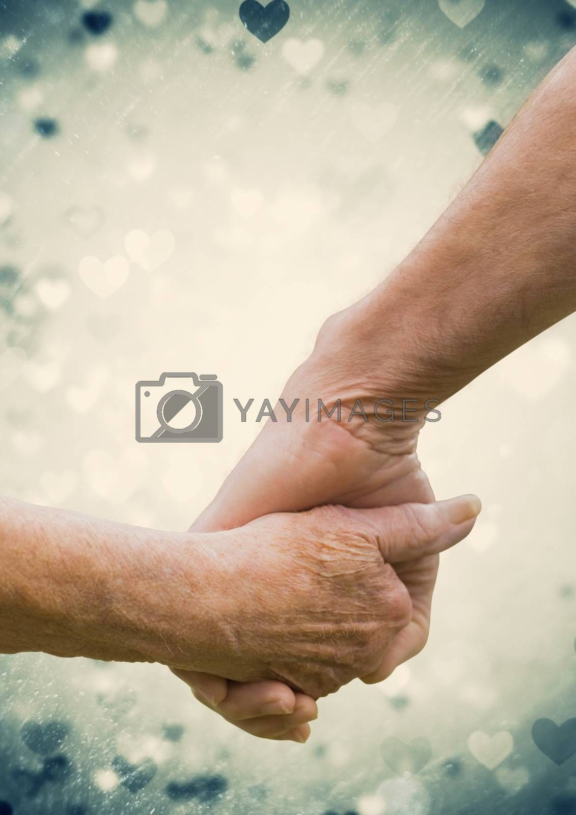 Hand of senior couple holding hands against digitally generated heart background